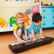 Boy and girl playing a musical instrument — Stock Photo