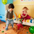 Stock Photo: Kids playing with dog and having party