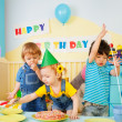 Three kids having fun on the birthday party — Stock Photo #10958143