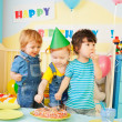Three kids eating cake on the birthday party — Stock Photo #10958145