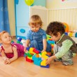 Kids playing with plastic blocks — Stock Photo #10958163