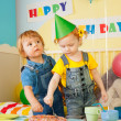 Two kids eating cake on the birthday party — Stock Photo #10958267