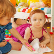Stock Photo: Boy and girl drawing with crayons