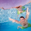 Happy man diving underwater — Stock Photo