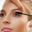 Separating and curling lashes with mascara brush — Stock Photo #10958725