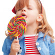 Little girl licking big lollipop — Stock Photo