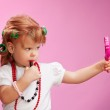 Little girl playing with mothers makeup — Stock Photo