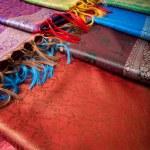 Different beautiful fabrics with fringe — Stock Photo #10959296