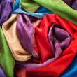 Rolls of fabrics on the table — Stock Photo