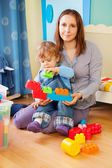 Mother and kid - playing with blocks — Stock Photo