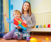 Playing with plastic blocks together — Stock Photo