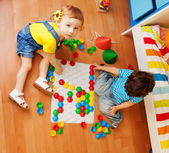 Kids and puzzle — Stock Photo