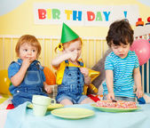 Boys and girl at the birthday party — Stock Photo