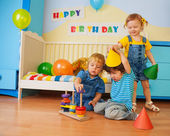 Boys and girl playing on birthday party — Foto Stock