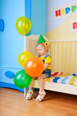 Little girl with balloons — Stock Photo