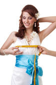 Measuring waist of a bride — Stock Photo