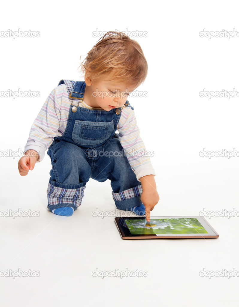 Young kid touching tablet pc (image on the screen from my portfolio) — Stock Photo #10956785