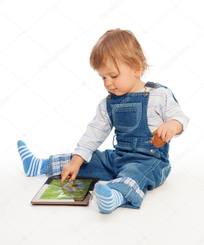Young kid playing with tablet pc (image on the screen from my portfolio) — Stock Photo #10956788