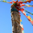 Totem Pole and Prayer Flags — Stock Photo