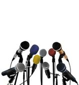 Press conference with standing microphones — Stock Photo