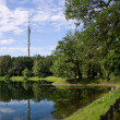 Lake in park with a kind on television tower Ostankino in Russia — Stock Photo