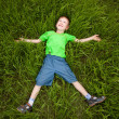 Little boy laying on the grass — Stock Photo #11754563