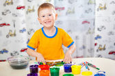 Boy with painted fingers — Stock Photo