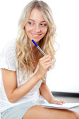 Blonde woman with pen and notepad — Stock Photo