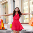 Happy woman with shopping bags — Stock Photo #11928651
