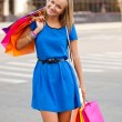 Happy woman with shopping bags — Stock Photo #11928657