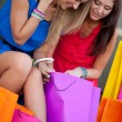 Two girls show each other the purchase — Stock Photo #11928701