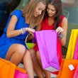 Two girls show each other the purchase — Stock Photo