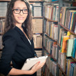 Brunette woman at library — Stock Photo #12065151