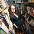 Stock Photo: Brunette woman at library
