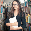 Brunette woman at library — Stock Photo