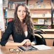 Brunette woman at library - Stock Photo