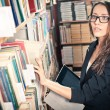 Brunette woman at library — Stock Photo #12065197