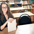 Woman sitting behind the desk at library — Stock Photo #12065233