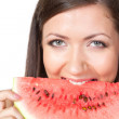Brunette woman holding watermelon — Stock Photo #12175334