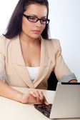 Businesswoman working with notebook — Stock Photo