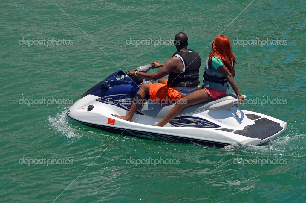 An afro-american couple enjoying an afternoon putting pm a rented jet ski in miami beach,florida  Stock Photo #10824261