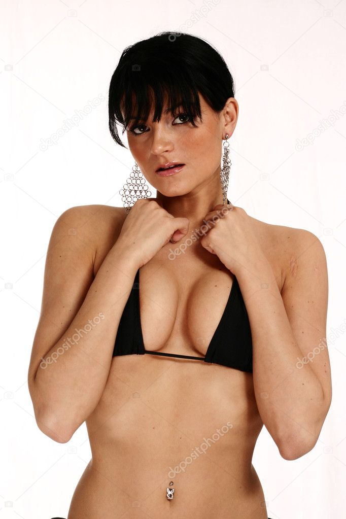 Perfect brunette woman posing in black bikini on white isolated background — Stock Photo #10999297