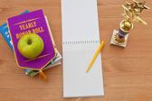 School awards and empty notebook — Stock Photo