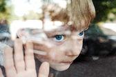 Child and window — Stock Photo