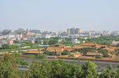 Forbidden City and modern buildings — Stock Photo