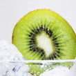 The kiwi with iced water — Stock Photo