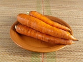 Carrot root on a plate — Stock Photo