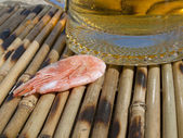 Shrimp near a glass with beer — Stock Photo