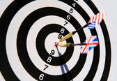 Dartboard with two darts in a bullseye — Stock Photo