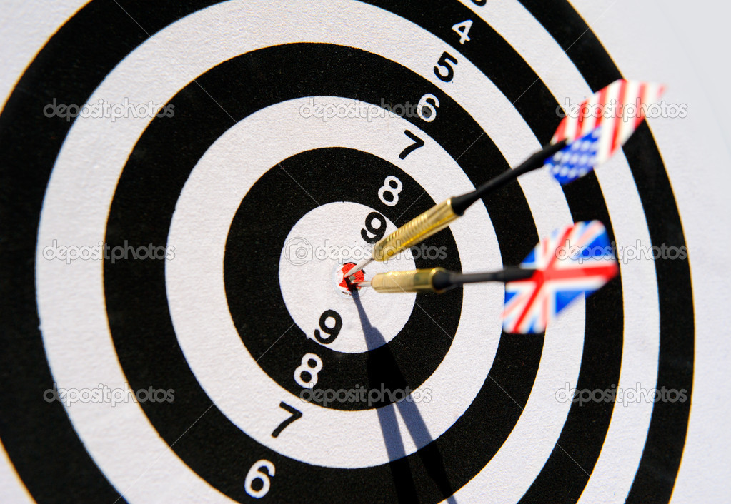 Dartboard with two darts in a bullseye — Stock Photo #10913631